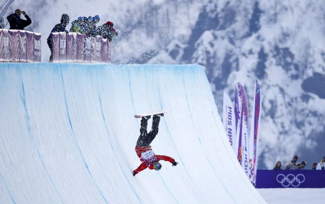 Poland's Michal Ligocki crashes during the men's snowboard halfpipe qualification round at the 2014 Sochi Winter Olympic Games in Rosa Khutor