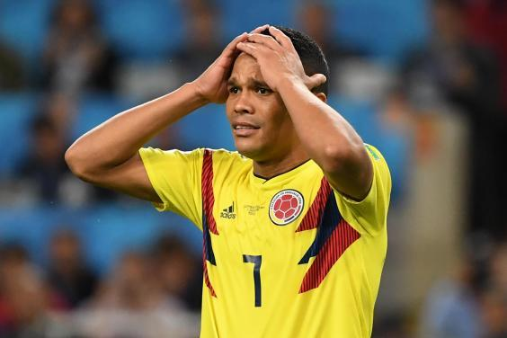 Colombia crash out early (AFP via Getty Images)