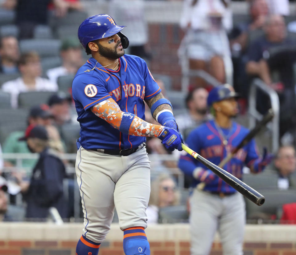 New York Mets' Jonathan Villar watches his two-run home run against the Atlanta Braves during the third inning of a baseball game Tuesday, May 18, 2021, in Atlanta. (Curtis Compton/Atlanta Journal-Constitution via AP)
