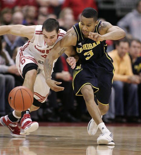 Ohio State's Aaron Craft (4) and Michigan's Trey Burke (3) vie for control of the ball during the second half of an NCAA college basketball game Sunday, Jan. 13, 2013, in Columbus, Ohio. Ohio State won 56-53. (AP Photo/Mike Munden)