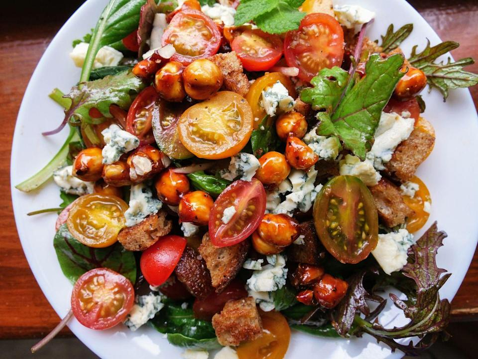 """<p>Delightful on all fronts: It's got leafy greens, juicy tomatoes, blue cheese, candied hazelnuts, <em>and</em> stove-top croutons, tossed in gingery balsamic vinaigrette.</p><p>Get the recipe from <a href=""""https://www.delish.com/cooking/recipe-ideas/a36806812/tomato-salad-recipe/"""" rel=""""nofollow noopener"""" target=""""_blank"""" data-ylk=""""slk:Delish"""" class=""""link rapid-noclick-resp"""">Delish</a>.</p>"""