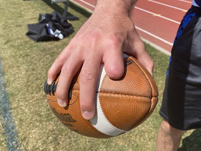 Quarterback Sam Vaulton lost half his index finger while trying to fix an ATV in eighth grade.