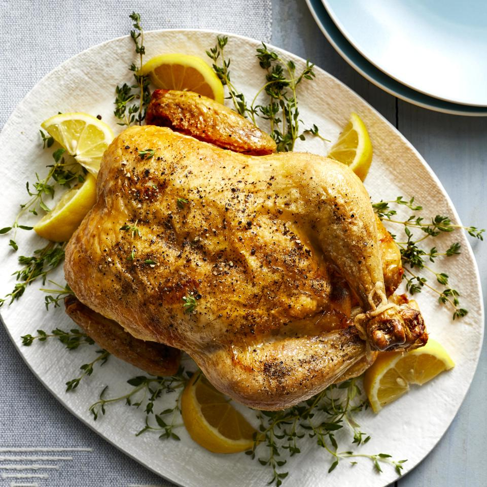 """<p>Replicate the flavor, lovely burnished skin and moist texture of a classic rotisserie chicken with this easy recipe for cooking a whole chicken in your air fryer. With just a handful of ingredients and 10 minutes of active time, you get a roast chicken with lemon and herbs that's a remarkable doppelganger for a deli chicken right after it comes out of the rotisserie--before it gets shriveled and dried out from sitting in the deli's holding case for hours. Serve this chicken with your favorite veggie sides for a healthy weeknight dinner or weekend supper. And if you're hosting a dinner party, cooking your main course in the air fryer is also a great way free up oven space for casseroles, rolls and other dishes. <a href=""""http://www.eatingwell.com/recipe/274295/air-fryer-rotisserie-chicken/"""" rel=""""nofollow noopener"""" target=""""_blank"""" data-ylk=""""slk:View recipe"""" class=""""link rapid-noclick-resp""""> View recipe </a></p>"""