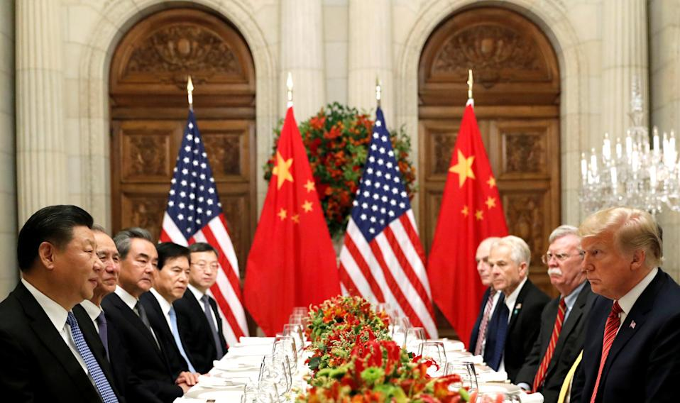 FILE PHOTO: U.S. President Donald Trump, U.S. Secretary of State Mike Pompeo, U.S. President Donald Trump's national security adviser John Bolton and Chinese President Xi Jinping attend a working dinner after the G20 leaders summit in Buenos Aires, Argentina December 1, 2018. Photo: REUTERS/Kevin Lamarque/File Photo