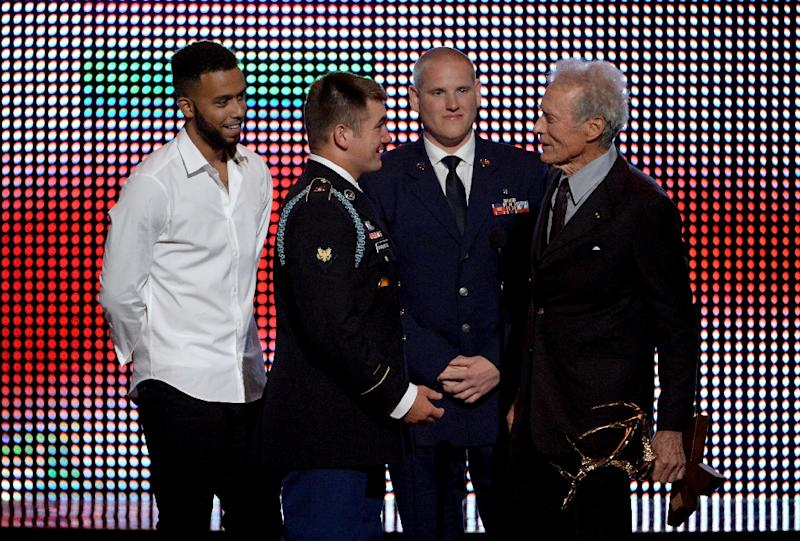 (L-R) Anthony Sadler, Alek Skarlatos, and Spencer Stone, who stopped a terrorist plot on a train bound for Paris, accept the Hero Award from Clint Eastwood