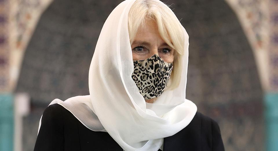 The Duchess of Cornwall visited a mosque in North London during the coronavirus pandemic, and wore a pair of very affordable (and stylish) slippers.  (Getty Images)