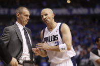FILE- In this May 17, 2011, file photo, Dallas Mavericks' Rick Carlisle and Jason Kidd talk during Game 1 of the NBA basketball Western Conference finals against the Oklahoma City Thunder in Dallas. Kidd is coming back to Dallas again, this time to replace the coach he won a championship with as the point guard of the Mavericks 10 years ago. A person with direct knowledge of the agreement says Kidd and the Mavericks agreed on a contract Friday, June 25, 2021, eight days after Carlisle resigned abruptly in the wake of general manager Donnie Nelson's departure. (AP Photo/Eric Gay, File)
