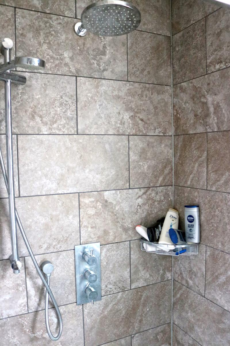 <strong>Barons Court Project fundraised to finance a revamped shower. 'It's like a hotel,' Mo told HuffPost</strong> (George Bowden/HuffPost UK)