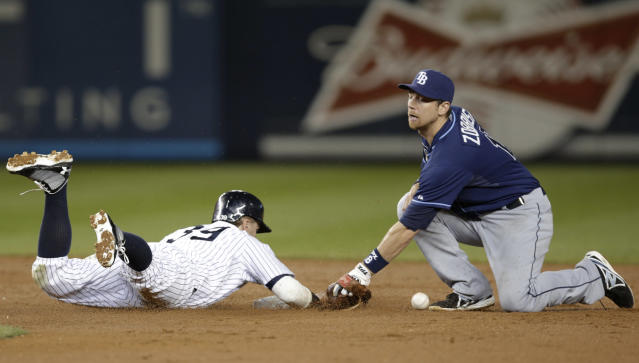 New York Yankees' Mark Reynolds (39) is safe at second on a second-inning sacrifice fly as Tampa Bay Rays second baseman Ben Zobrist loses the ball in a baseball game Wednesday, Sept. 25, 2013, in New York. (AP Photo/Kathy Willens)
