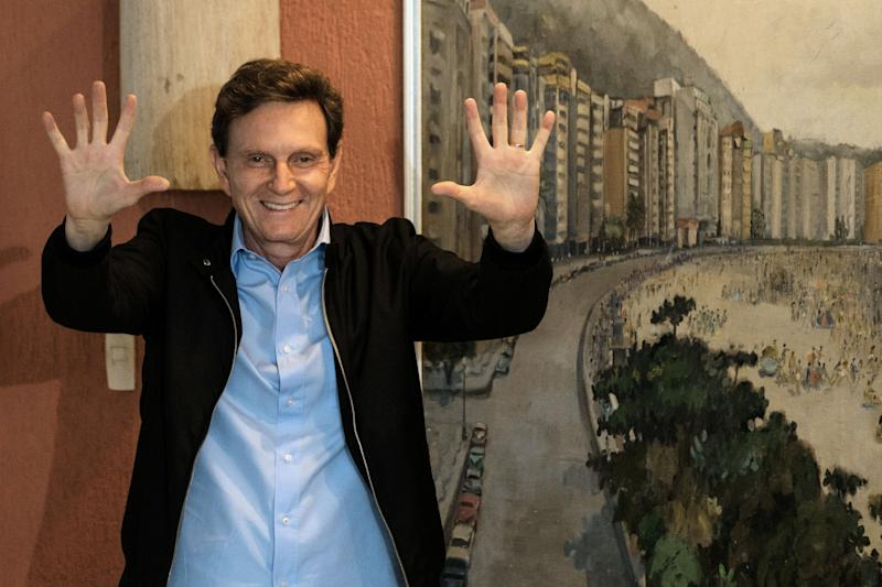 Rio de Janeiro's mayoral candidate for the Brazilian Republican Party (PRB) Marcelo Crivella gestures after casting his vote at a polling station during the municipal election runoff in Rio de Janeiro, Brazil, on October 30, 2016. An evangelical mega-church bishop who once branded Catholics demons was expected to become mayor of Rio de Janeiro on Sunday in nationwide municipal elections confirming Brazil's shift to the right. / AFP / YASUYOSHI CHIBA (Photo credit should read YASUYOSHI CHIBA/AFP via Getty Images)