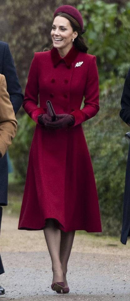 """<p>For <a rel=""""nofollow"""" href=""""https://www.harpersbazaar.com/celebrity/latest/a25673328/kate-middleton-red-coat-hat-royal-family-church-service/"""">Christmas morning service</a>, the Duchess of Cambridge looked festive in a deep red coat with a velvet collar by designer Catherine Walker. </p>"""