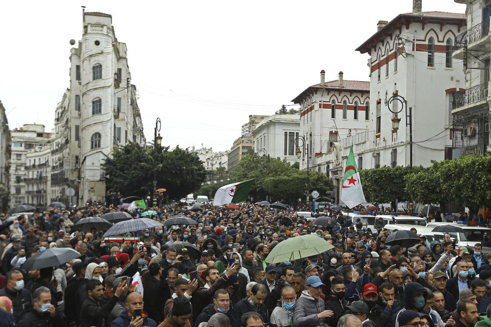 Algerians take the streets as they demonstrate in Algiers to mark the second anniversary of the Hirak movement, Monday Feb. 22, 2021. February 22 marks the second anniversary of Hirak, the popular movement that led to the fall of Algerian President Abdelaziz Bouteflika. (AP Photo/Anis Belghoul)