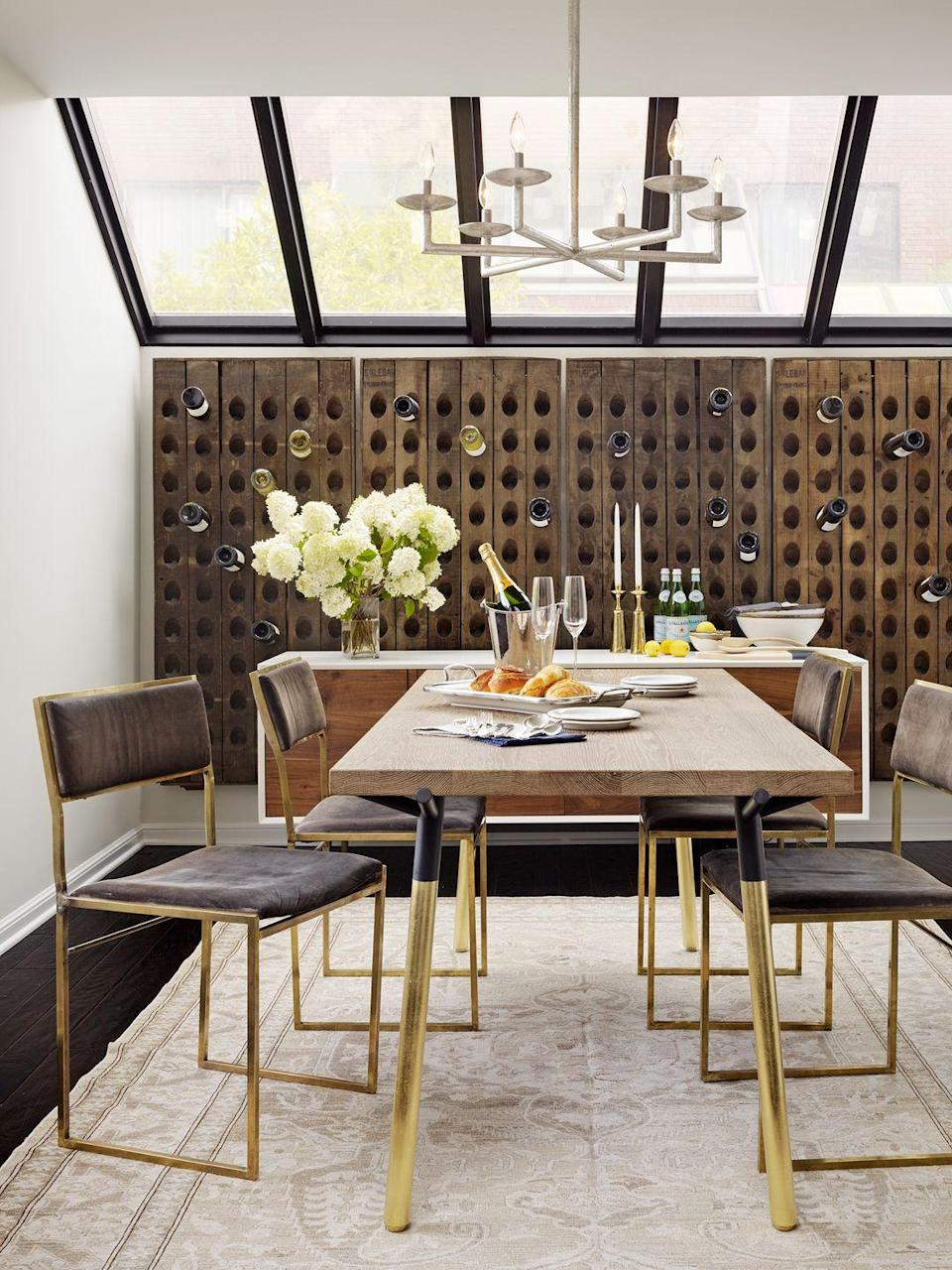 """<p>In this dining room by <a href=""""https://www.catherinekwong.com/"""" rel=""""nofollow noopener"""" target=""""_blank"""" data-ylk=""""slk:Catherine Kwong Design"""" class=""""link rapid-noclick-resp"""">Catherine Kwong Design</a>, the entire back wall is dedicated to wine. It makes entertaining easier when you can simply grab and pour without even leaving the room. Plus, if your basement has a skylight, even more reason to turn into a special occasion room, right?</p>"""
