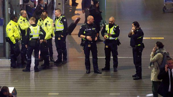 PHOTO: Dutch police stand around at Schiphol airport in Amsterdam, Netherlands, Nov. 6, 2019. (Peter Dejong/AP)