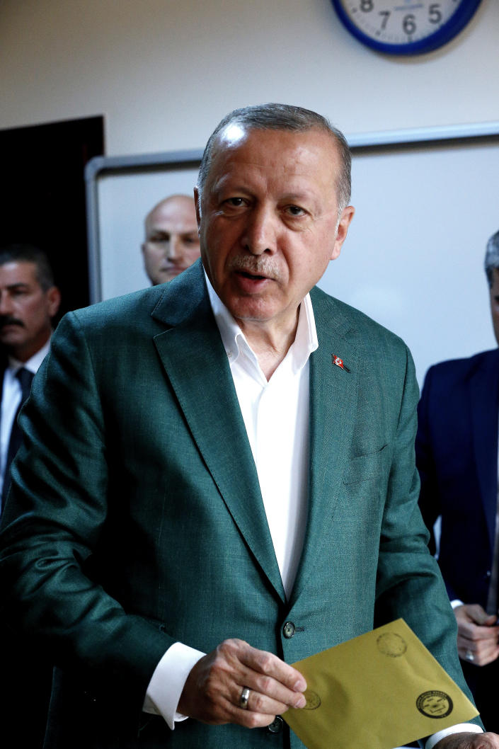 Turkey's President Recep Tayyip Erdogan, casts his ballot during the local elections, in Istanbul, Sunday, March 31, 2019. Mayoral elections are underway in 30 large cities in Turkey along with other municipal races Sunday that are seen as a barometer of President Recep Tayyip Erdogan's popularity amid a sharp economic downturn in the nation straddling Europe and Asia. (AP Photo/Lefteris Pitarakis)