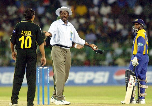 COLOMBO - SEPTEMBER 12:  Shahid Afridi (No.10) of Pakistan has to be calmed down by umpire Steve Bucknor after a row with Aravinda de Silva of Sri Lanka during the ICC Champions Trophy match between Sri Lanka and Pakistan on September 12, 2002 played at the R. Premadasa Stadium in Colombo, Sri Lanka. Sri Lanka won the match by 8 wickets. (Photo by Tom Shaw/Getty Images)