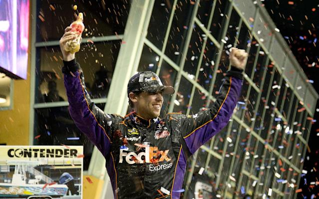 Denny Hamlin celebrates after winning the NASCAR Sprint Cub Series auto race in Homestead, Fla., Sunday, Nov. 17, 2013. (AP Photo/J Pat Carter)