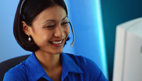 Smiling woman wearing phone headset