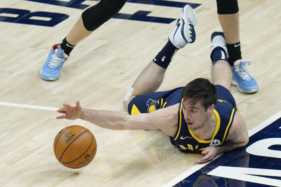 Indiana Pacers guard T.J. McConnell fails to keep a loose ball in play during the first half of the team's NBA basketball game against the Miami Heat in Indianapolis, Wednesday, March 31, 2021. (AP Photo/AJ Mast)