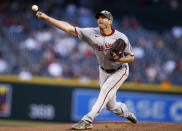 Washington Nationals' Max Scherzer delivers a pitch against the Arizona Diamondbacks during the first inning of a baseball game Friday, May 14, 2021, in Phoenix. (AP Photo/Darryl Webb)