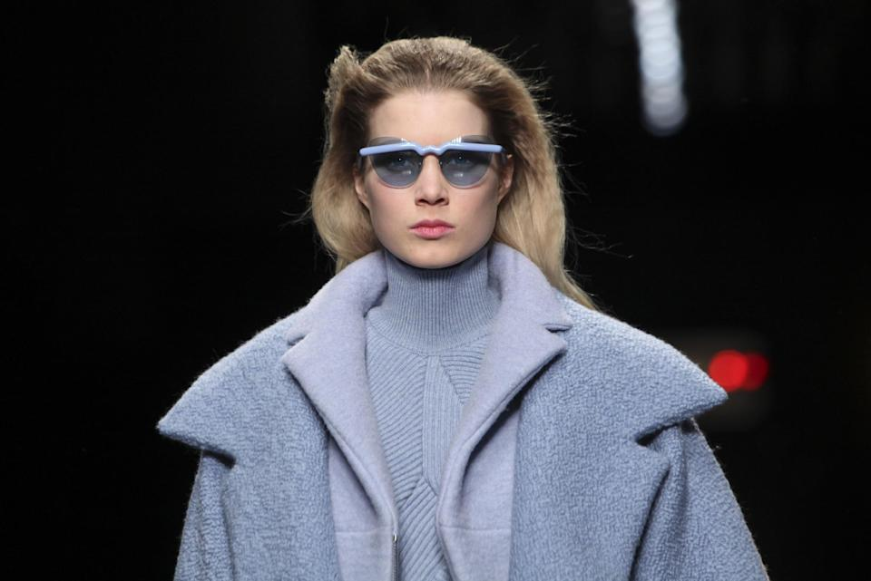 A model presents a creation by French fashion designer Guillaume Henry for Carven Ready to Wear's Fall-Winter 2013-2014 fashion collection, presented Thursday, Feb.28, 2013 in Paris. (AP Photo/Thibault Camus)