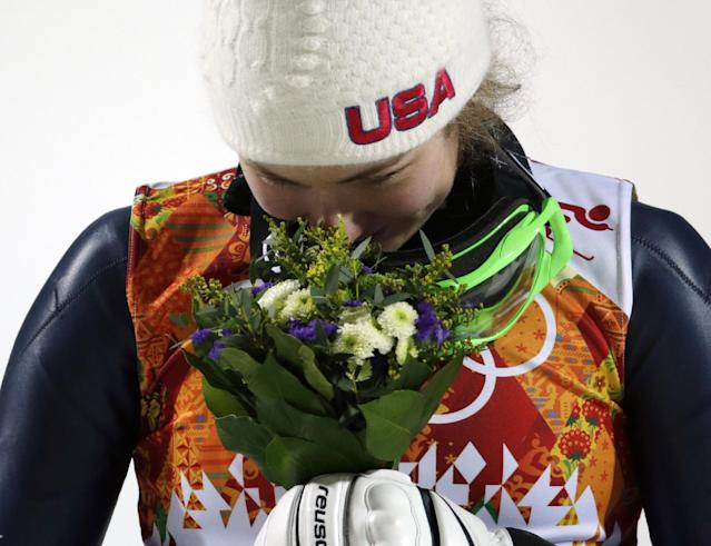 Women's slalom gold medal winner Mikaela Shiffrin of the United States smells her bouquet during a flower ceremony at the Sochi 2014 Winter Olympics, Friday, Feb. 21, 2014, in Krasnaya Polyana, Russia. (AP Photo/Gero Breloer)