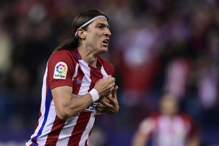 Atletico Madrid's defender Filipe Luis celebrates after scoring during the Spanish league football match Club Atletico de Madrid vs Real Sociedad at the Vicente Calderon stadium in Madrid on April 4, 2017