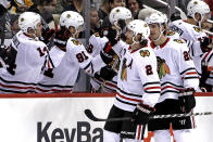 Chicago Blackhawks' Duncan Keith (2) returns to the bench after scoring during the second period of an NHL hockey game against the Pittsburgh Penguins in Pittsburgh, Sunday, Jan. 6, 2019. (AP Photo/Gene J. Puskar)