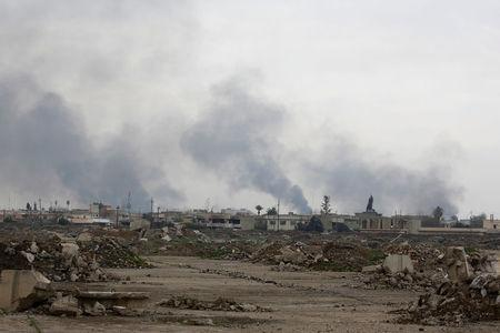 Smoke rises from clashes during a battle between Iraqi forces and Islamic State militants, as seen from Mosul Airport which is being ran by Iraqi forces, in the city of Mosul