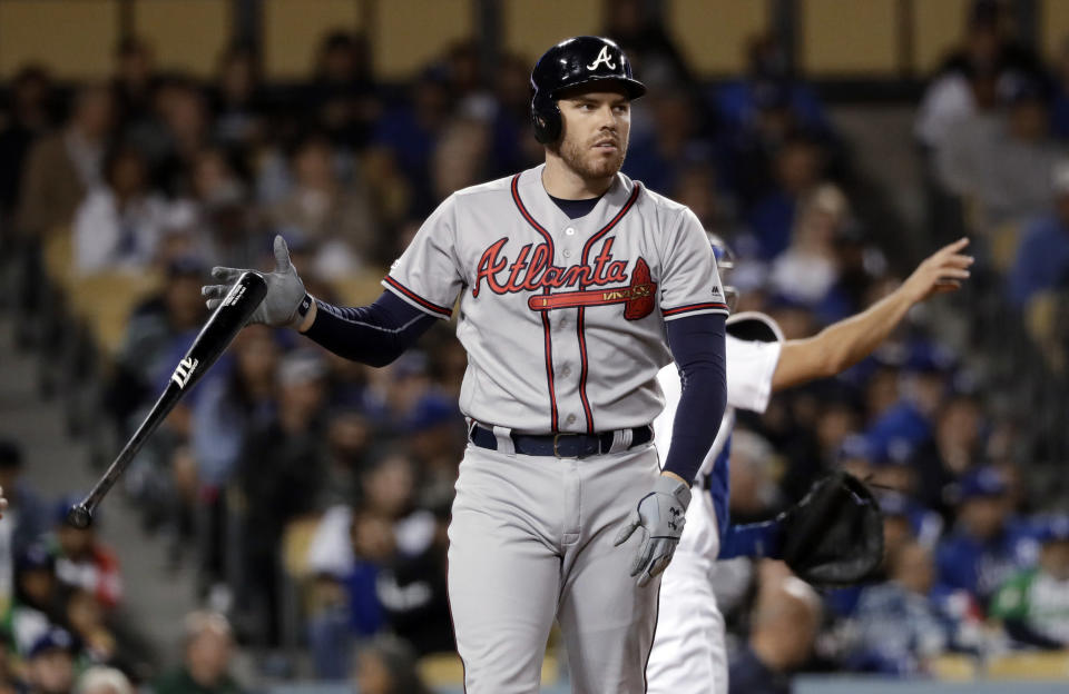Atlanta Braves' Freddie Freeman tosses his bat after striking out during the fifth inning of the team's baseball game against the Los Angeles Dodgers on Wednesday, May 8, 2019, in Los Angeles. (AP Photo/Marcio Jose Sanchez)