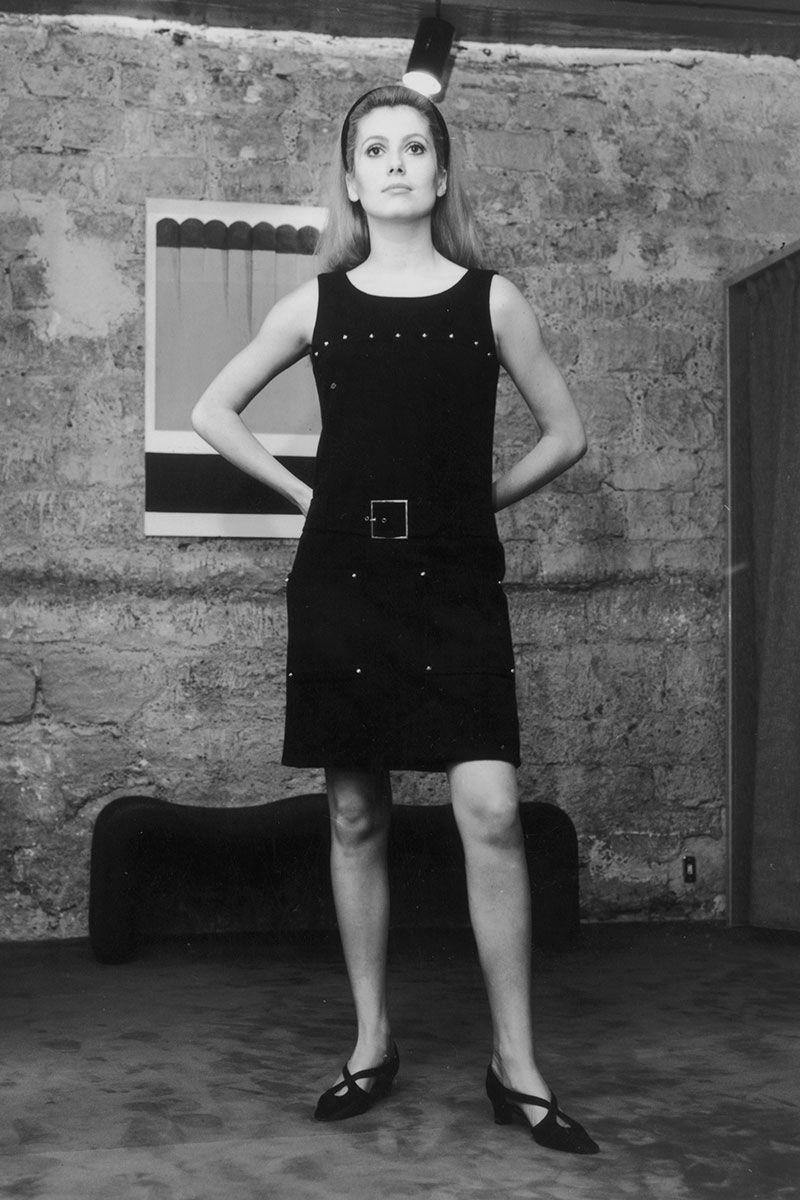 <p>French actress Catherine Deneuve added a bit of flair to her simple black dress with a gold square belt and metal embellishments. </p>