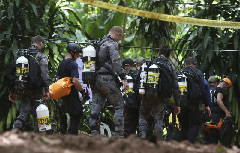 International rescuers team prepare to enter the cave where a young soccer team and their coach trapped by flood waters Thursday