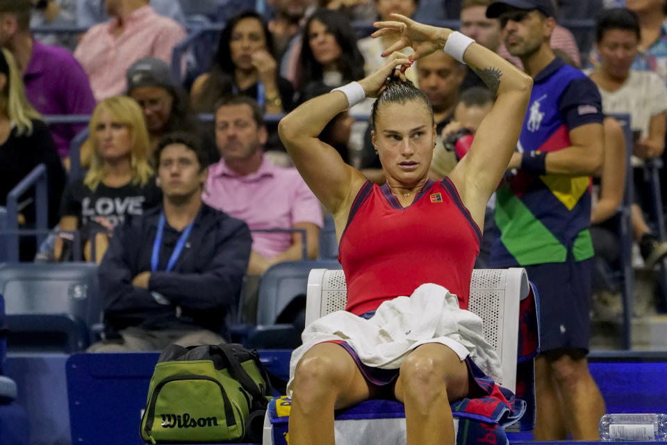 Aryna Sabalenka,of Belarus, adjusts her hair tie during a break between games against Leylah Fernandez, of Canada, during the semifinals of the US Open tennis championships, Thursday, Sept. 9, 2021, in New York. (AP Photo/Elise Amendola)