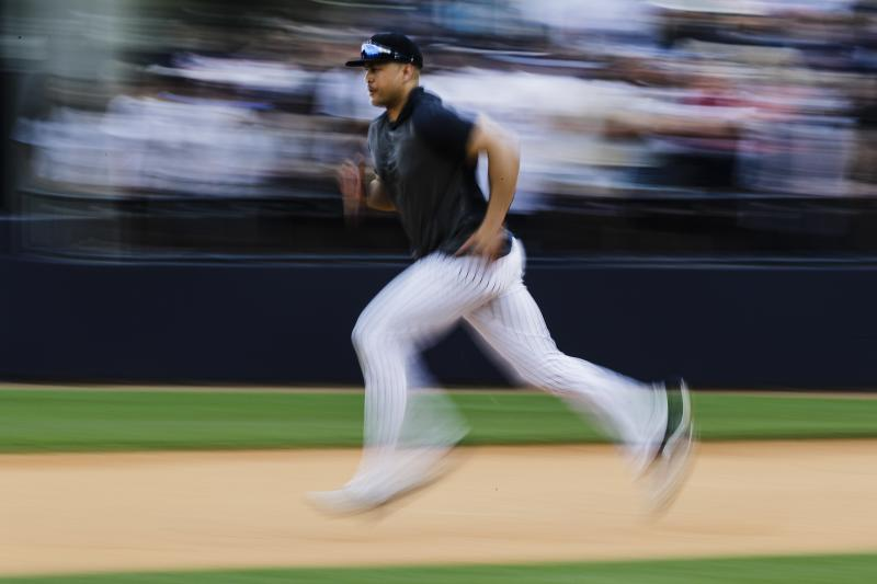 New York Yankees' Giancarlo Stanton runs during a spring training baseball workout Thursday, Feb. 20, 2020, in Tampa, Fla. (AP Photo/Frank Franklin II)