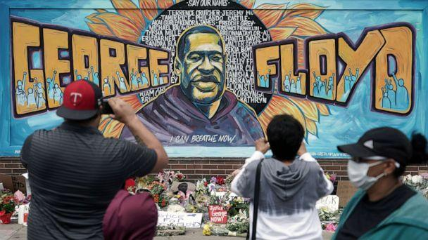 PHOTO: People gather at a memorial mural painted outside the Cup Foods store on Chicago Avenue in South Minneapolis where George Floyd died at the hands of police, Friday, May 29, 2020 in Minneapolis. (Brian Peterson/AP Photo)