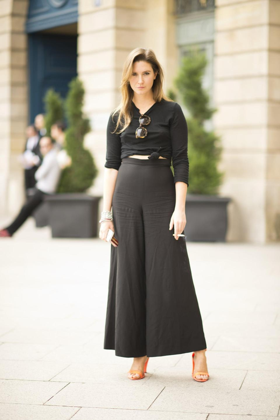 <p>We're obsessed with this black-on-black look. Thanks to flowy high-waisted trousers and citrus heels, this look is still decidedly summery.</p>