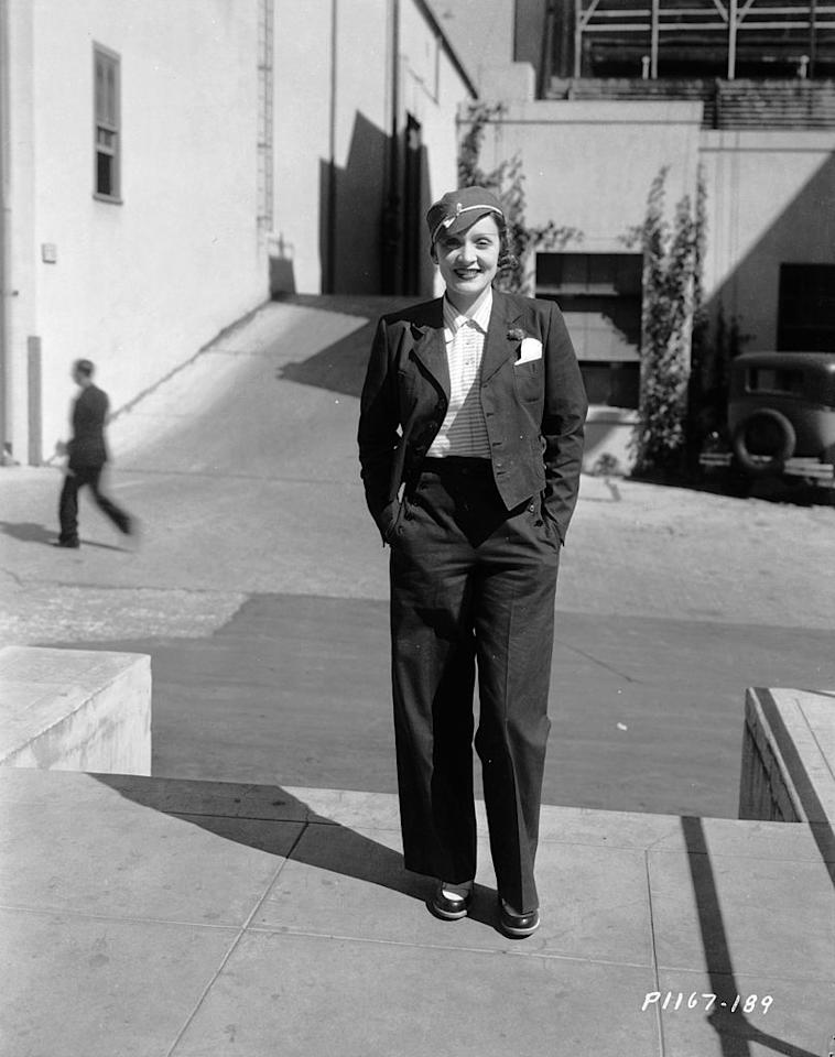 <p>European designers Elsa Schiaparelli and Coco Chanel combined bravado with feminine sensibility to create structured wool suits for their well-heeled clients (like Marlene Dietrich, pictured above), who didn't mind a bit of androgyny during the '30s. <i>(Photo via Getty Images)</i></p>