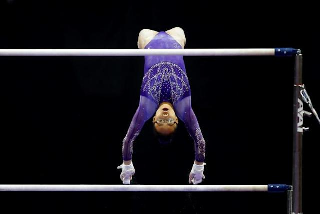 Morgan Hurd competes on the uneven bars (AFP Photo/JAMIE SQUIRE)