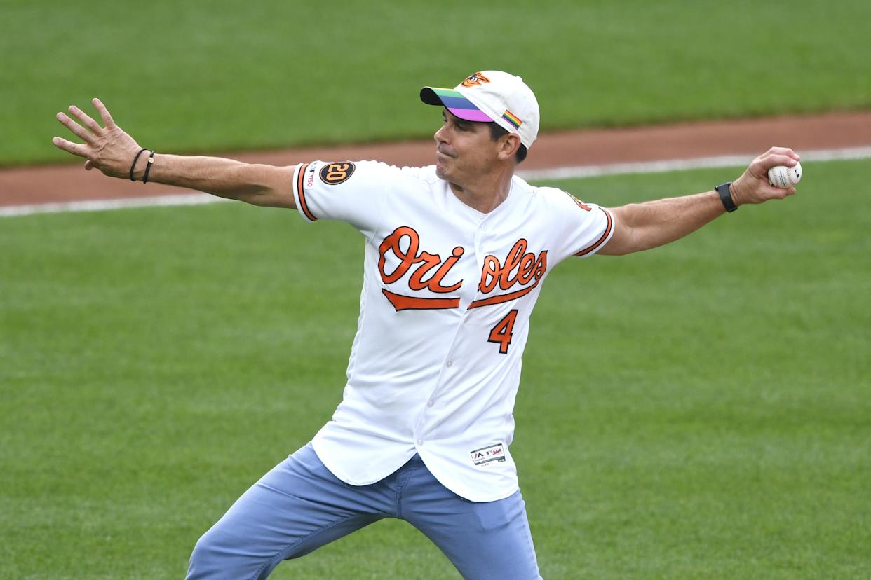 BALTIMORE, MD - JUNE 12:  Former baseball player Billy Bean throws out the first pitch before a baseball game between the Baltimore Orioles and the Toronto Blue Jays at Oriole Park at Camden Yards on June 12, 2019 in Baltimore, Maryland.  (Photo by Mitchell Layton/Getty Images)