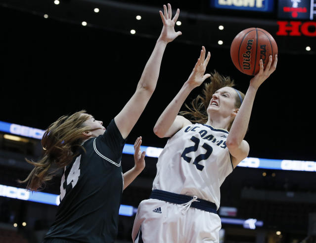 FILE - In this Saturday, March 16, 2019, file photo, UC Davis forward Morgan Bertsch (22) shoots over Hawaii center Lauren Rewers (14) during the second half of an NCAA college basketball game in the championship of the the Big West conference tournament title in Anaheim, Calif. Bertsch is UC Davis first Big West Conference player of the year and the leading scorer in school history. (AP Photo/Alex Gallardo)