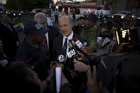 Pennsylvania Governor Tom Wolf speaks to reporters after an Amtrak passenger train derailed in Philadelphia, Pennsylvania May 13, 2015. The train was barreling into a curved stretch of track at 100-plus miles per hour, twice the speed limit, when the engineer slammed on the brakes, U.S. investigators said on Wednesday. REUTERS/Charles Mostoller