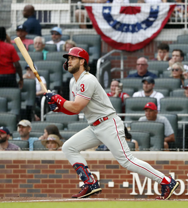 Philadelphia Phillies' Bryce Harper watches his RBI base hit in the first inning of a baseball game against the Atlanta Braves on Thursday, July 4, 2019, in Atlanta. (AP Photo/John Bazemore)