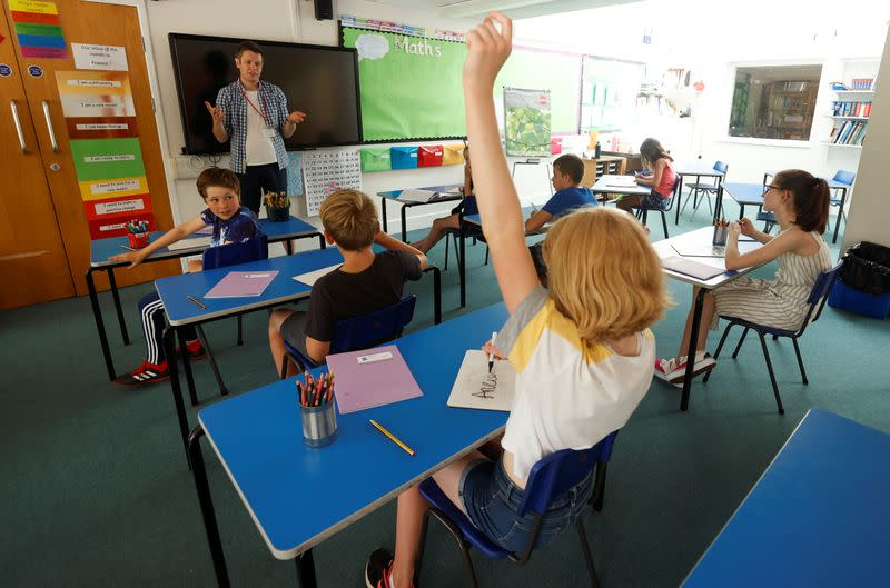 UK government health advisers say missing school is greater risk to kids than COVID