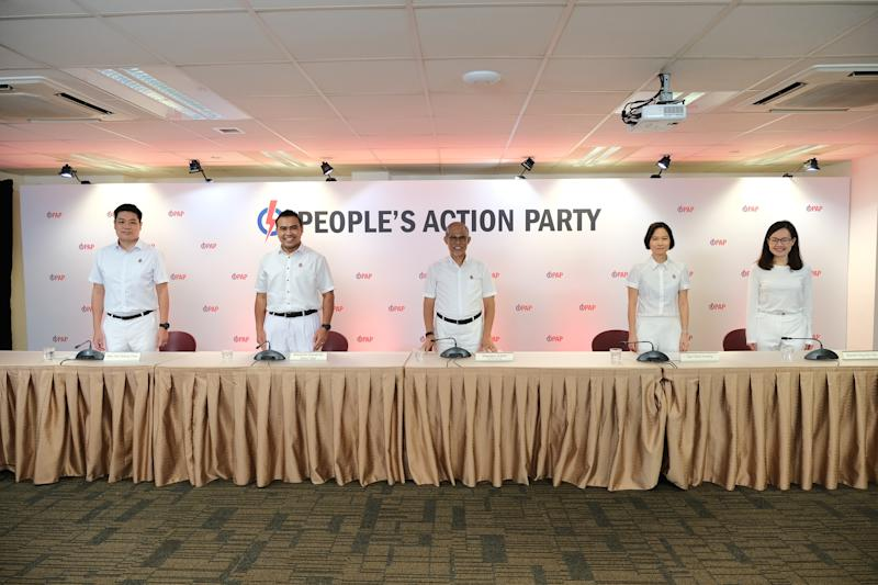 PAP vice-chairman Masagos Zulkifli (centre) unveils four new party candidates for the upcoming General Election: (from left) Alex Yeo, Sharael Taha, Gan Siow Huang and Rachel Ong. (PHOTO: PAP)
