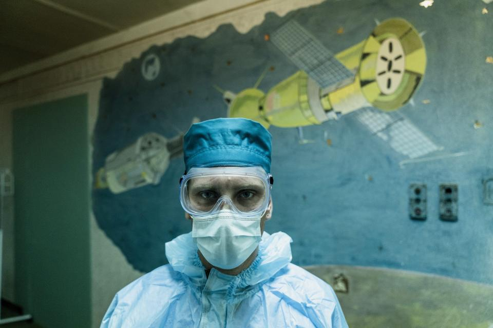 Ruslan Kushnir, medical worker, wearing a special suit to protect himself against coronavirus stands ready to meet a new patient with COVID-19 in a hospital organized in the medical college in Lviv, Western Ukraine, on Monday, Jan. 4, 2021. (AP Photo/Evgeniy Maloletka)