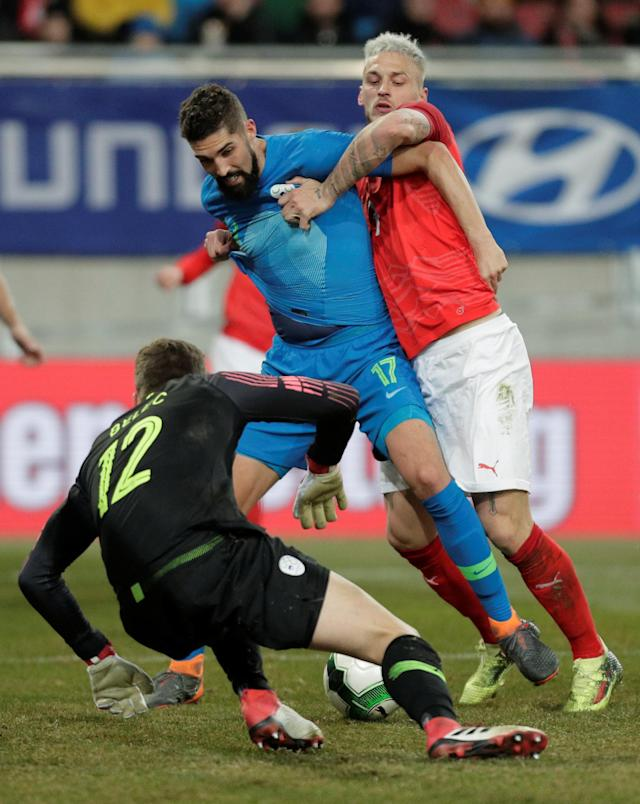 Soccer Football - International Friendly - Austria vs Slovenia - Worthersee Stadium, Klagenfurt, Austria - March 23, 2018 Slovenia's Miha Mevlja and Vid Belec in action with Austria's Marko Arnautovic REUTERS/Heinz-Peter Bader