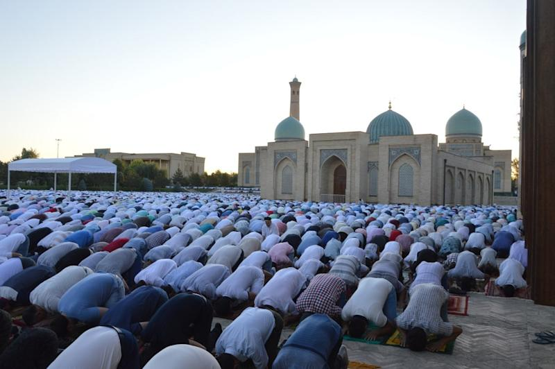 Muslims pray during the Eid al-Fitr holiday in Tashkent, Uzbekistan