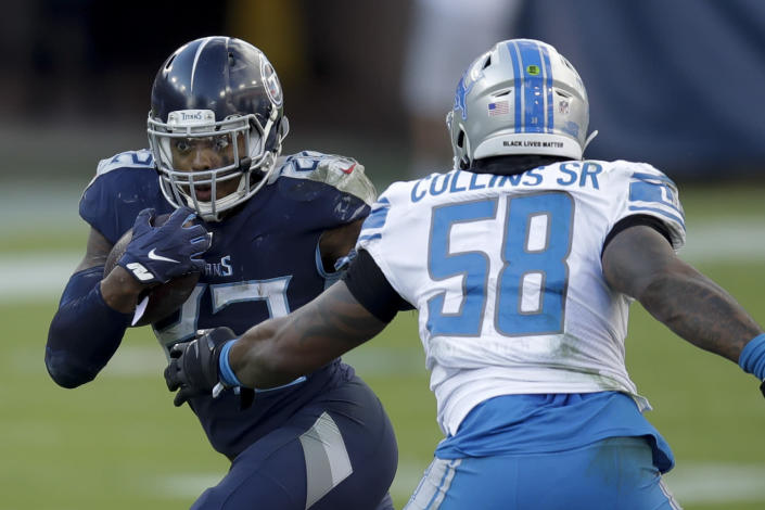 FILE - In this Dec. 20, 2020, file photo, Tennessee Titans running back Derrick Henry , left, runs past Detroit Lions outside linebacker Jamie Collins during the second half of an NFL football game in Nashville, Tenn. Henry led the NFL with 1,540 yards rushing last season before running the Titans to their first AFC championship game in 17 years. (AP Photo/Ben Margot, File)