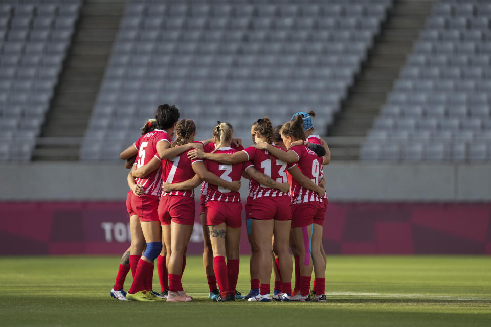 Russian Olympic Committee team players huddle up at the start of their women's rugby sevens 7-8 placing match against China at the 2020 Summer Olympics, Saturday, July 31, 2021 in Tokyo, Japan. (AP Photo/Shuji Kajiyama)
