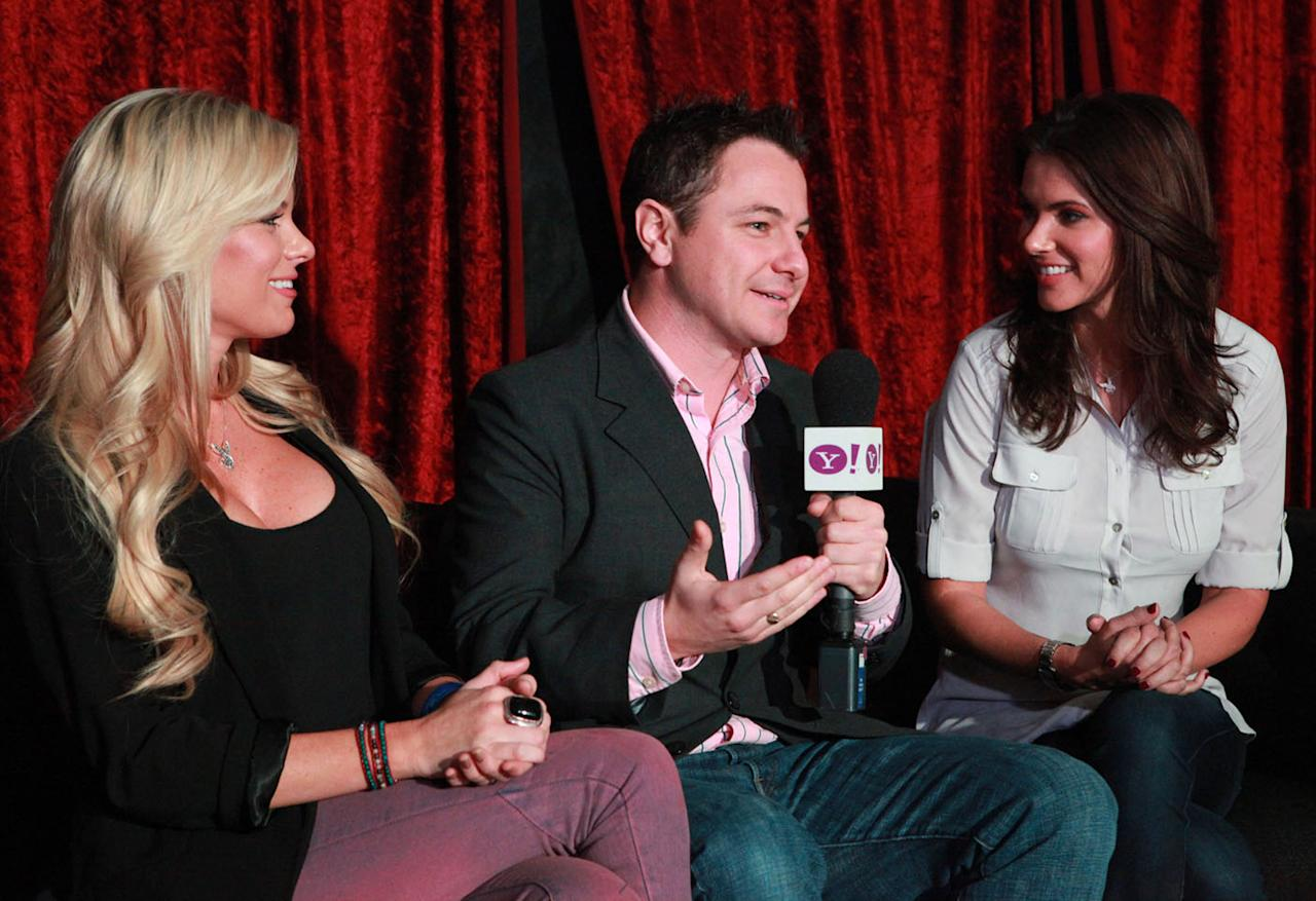 Yahoo! reporter Martin Rogers interviews Playboy Playmates Tiffany Selby (L) and Alison Waite at the Bud Light Hotel in Indianapolis.